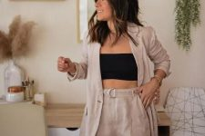 a tan linen suit with an oversized blazer, a black crop top is a lovely outfit for a hot summer day at work