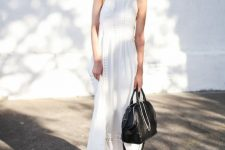 a white boho lace midi dress with no sleeves, black birkenstocks, a black bag and a hat for an ultimate look