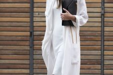 a white knee dress, white duster, birkenstocks and a black clutch for a minimal and chic look