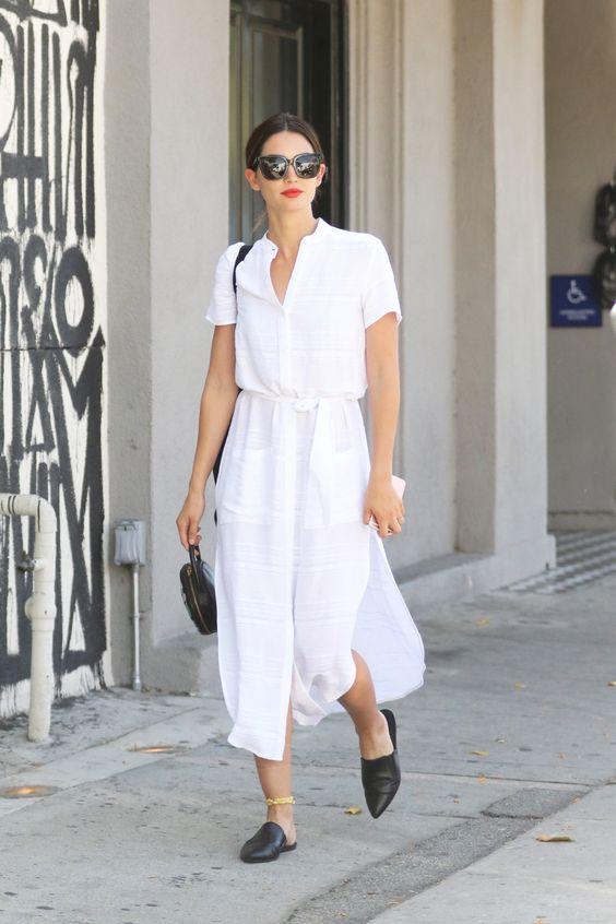 a white linen midi shirtdress with short sleeves, black mules and a black round bag for a hot working day