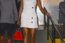 a white sleeveless mini dress on buttons, two tone shoes and a matching bag for a bold and sexy summer work look
