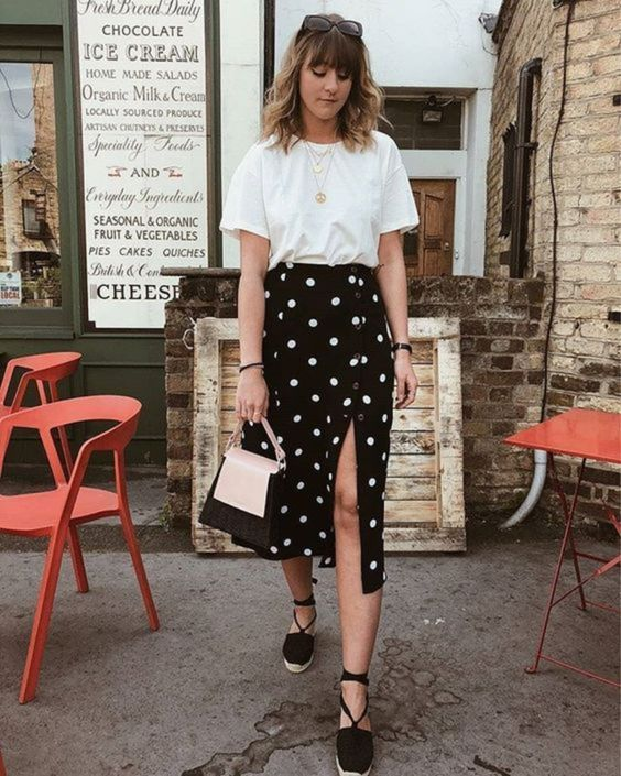 a white t-shirt, a black polka dot button up midi skirt, black espadrilles and a two tone bag for a cool girlish look