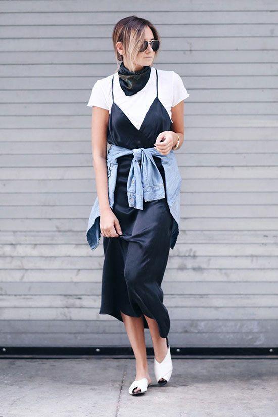 a white t-shirt, a black slip midi dress, white mules, a chambray shirt and neck tier