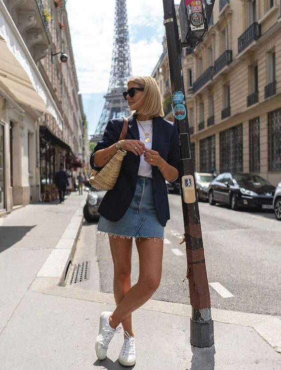 a white t-shirt, a navy blazer, a blue denim mini, white sneakers and a straw bag for a casual summer look