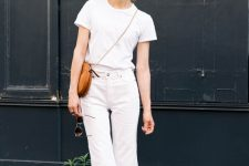a white tee, white flare jeans, catchy printed slippers and an amber round bag
