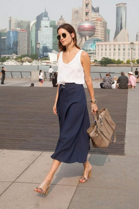 a white top, a navy midi skirt with a belt, comfy heels and a grey tote for a hot summer day