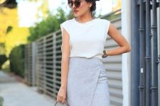 a white top with cap sleeves, a grey wrap linen mini skirt, a brown bag for a hot summer day at work