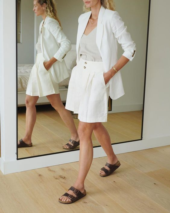 a work look with a white linen suit with Bermudas, a neutral top, Birkenstocks for summer