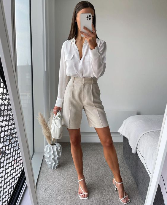 a work look with a white shirt, creamy linen Bermudas, white square toe heels and a white clutch