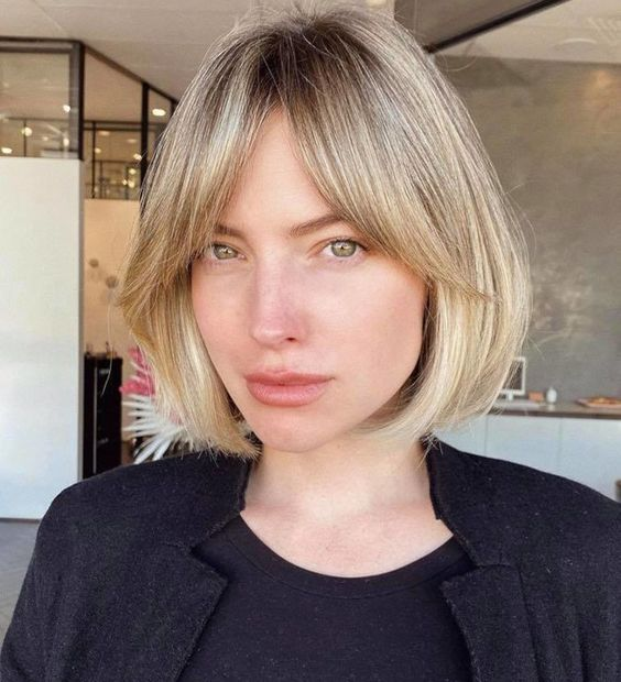 an elegant blonde short bob with curtain bangs is a lovely and chic idea to rock anytime