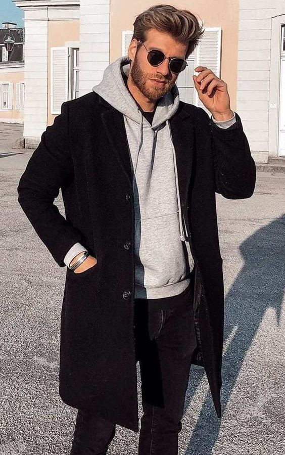 a black t-shirt, a grey hoodie, a black short coat, black jeans for a comfortable look on a cold day