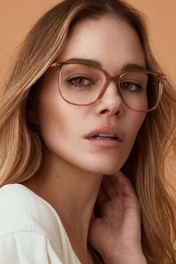a rounded cat eye shape is a timeless idea with a nerdy feel, and such a neutral tan frame is a trendy solution for today