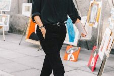 03 an elegant fall look with a black shirt, black cropped jeans, two tone shoes, a belt, sunglasses and a watch