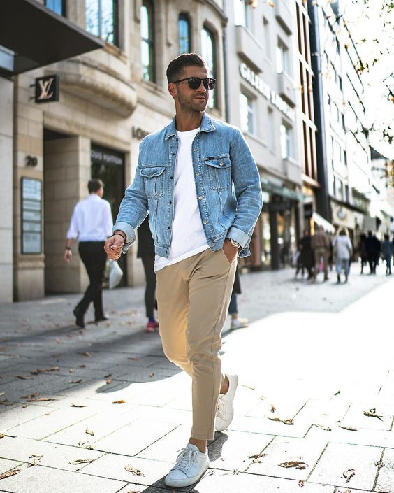 a cool summer to fall look with a white tee, tan trousers, a blue denim jacket and white sneakers