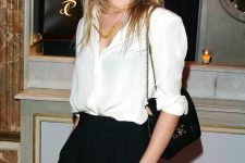 05 a timeless work outfit with an oversized white shirt, black high waisted pants, a black bag and a statement necklace