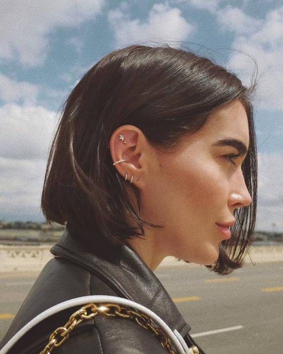 elegant ear styling with a double lobe, a conch and a double flat piercing, with rhinestone hoops and studs is a chic idea