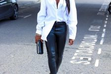 06 a chic outfit with a white oversized shirt, black leggings, black heels and a clutch looks very edgy