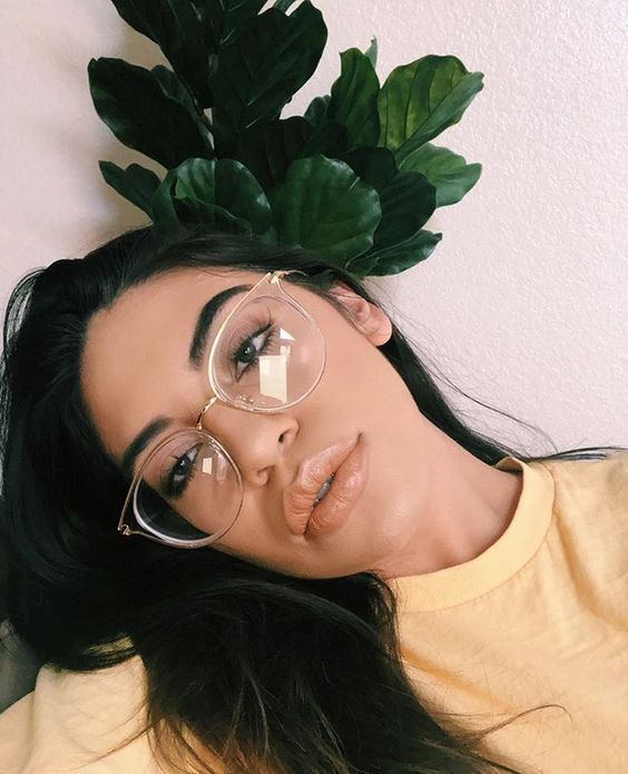 a clear round cat eye oversized frame is a trendy idea that will match most of your outfits easily