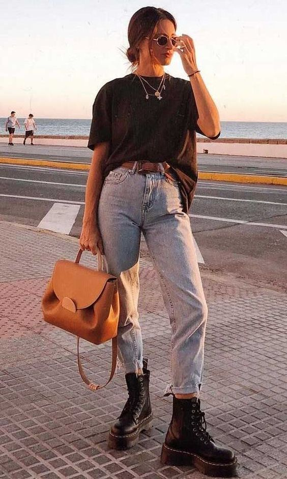 a simple look with a black t-shirt, layered necklaces, bleached jeans, black combat boots and an amber backpack