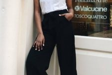 08 a white t-shirt, black culottes, white sneakers and sunglasses make up a cool and casual fall look