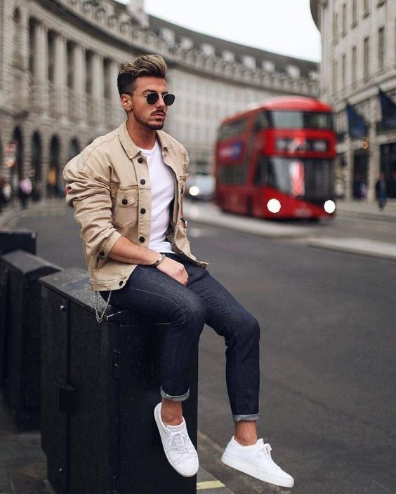 an easy and stylish outfit with a white t-shirt and sneakers, navy jeans, a tan jacket and sunglasses