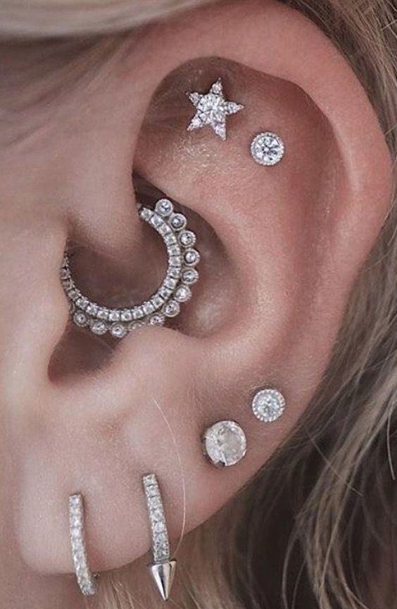glam ear styling with a multiple lobe, a double flat and a daith piercing, with gorgeous shiny studs and rhinestone hoops