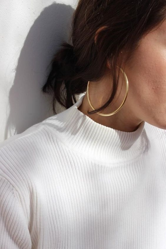 oversized yellow gold statement hoop earrings are a cool solution for any party look and will be bold with many outfits