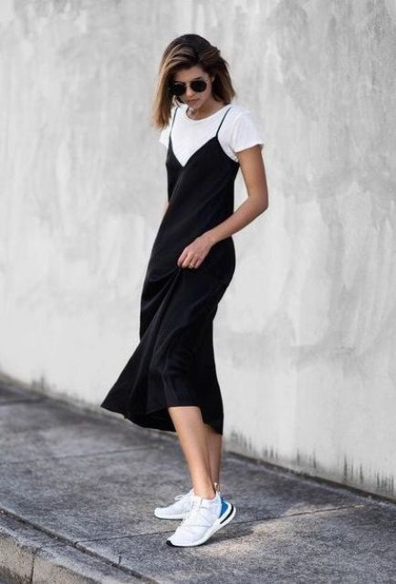 a white t shirt, a black slip midi dress, white tainers for a stylish and feminine fall outfit