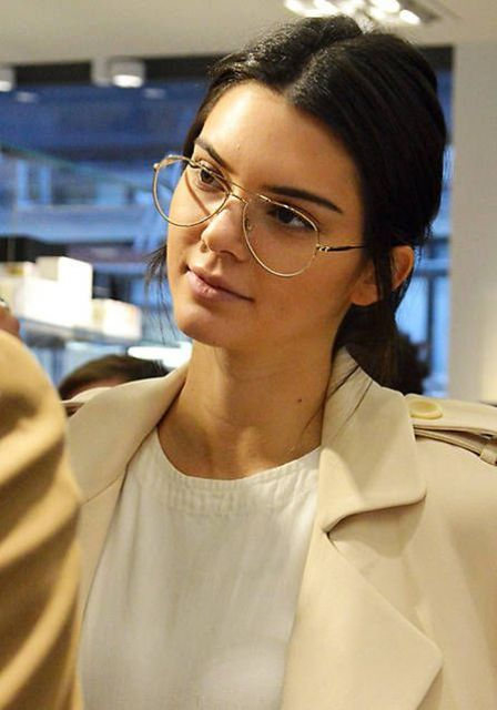 Kendall Jenner wearing aviator glasses in a thin gold metal frame looks amazing, trendy and bold
