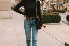 11 a black turtleneck, blue jeans with a belt, snake skin print boots, a black bag for a basic fall look