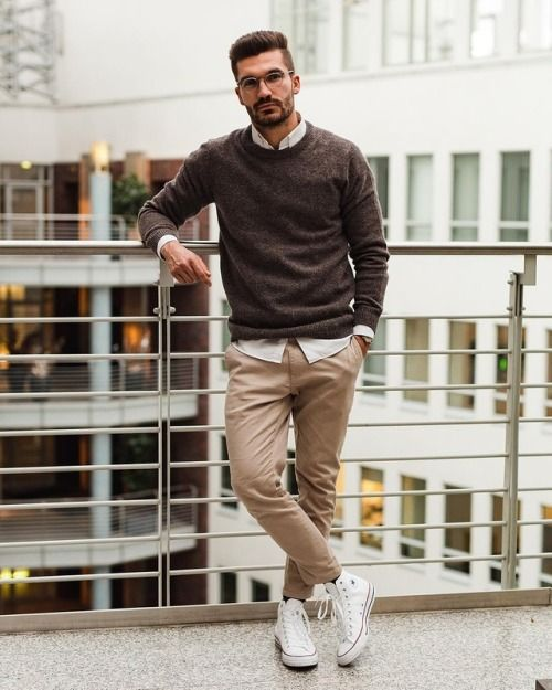 a stylish monochromatic work look with a white shirt, a brown jumper, tan trousers, white sneakers