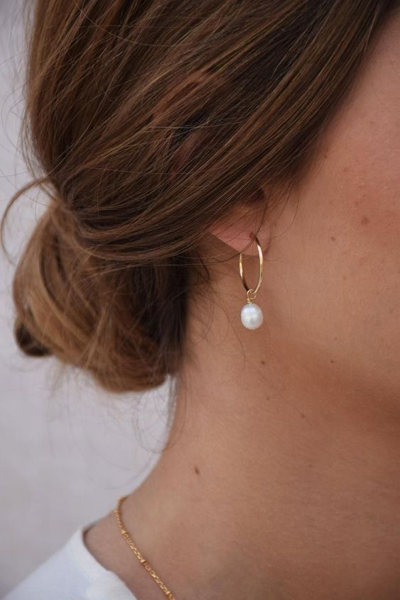 hoop earrings spruced up with pearls are a fresh and girlish solution that gives a delicate feel to the look