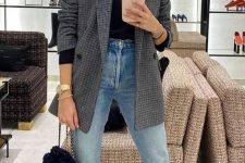 12 a black turtleneck, blue jeans, black boots, a grey plaid oversized blazer, a black bag for a casual look