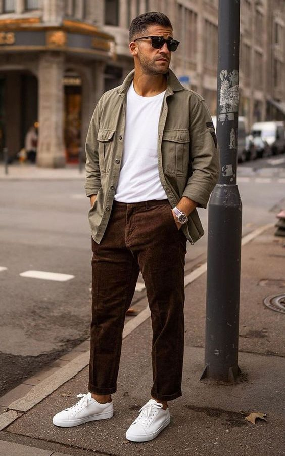 a white t-shirt, an army jacket, brown corduroy pants, white sneakers for a simple and comfortable look