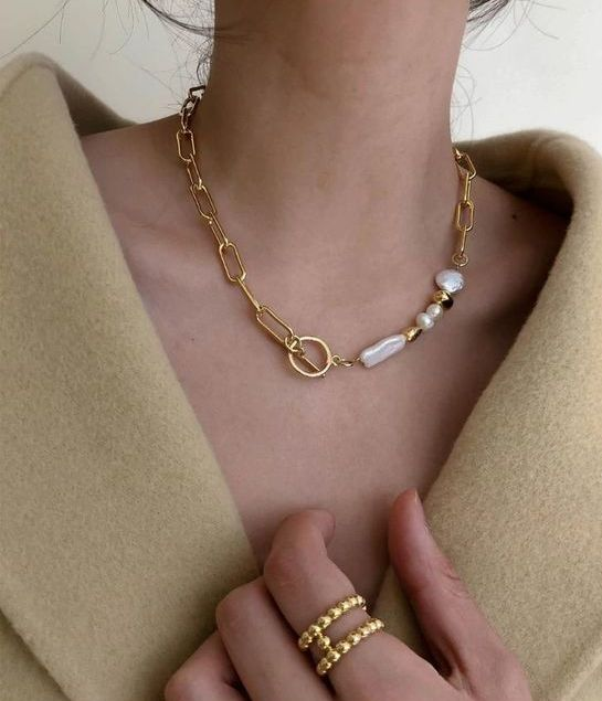 a very beautiful gold chain necklace with gold and baroque pearl beads is a fashionable idea that will match many looks