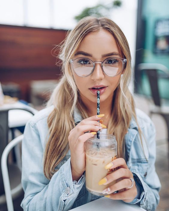 round glasses in a clear grey frame are a great alternative to usual clear frames, with a touch of color
