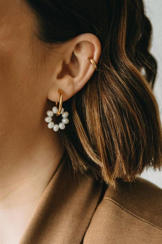 a catchy gold hoop and pearl hoop earring is a very chic and stylish idea that comprises two trends in one