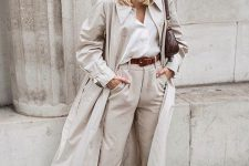 15 a comfortable work look with a white shirt, neutral high waisted pants, snakeskin print boots, a neutral trench and a burgundy bag