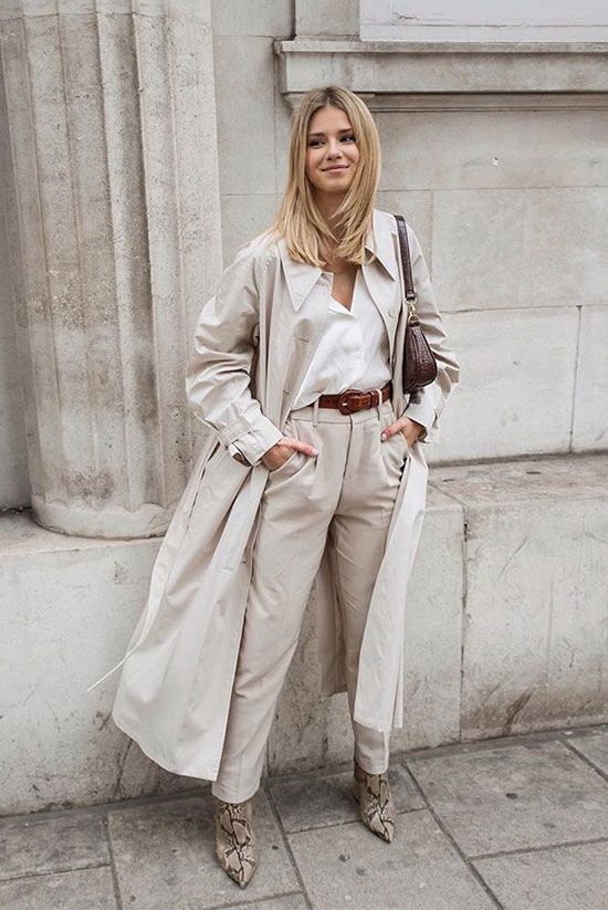 a comfortable work look with a white shirt, neutral high waisted pants, snakeskin print boots, a neutral trench and a burgundy bag