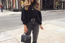 16 a monochromatic look with a black sweater, grey mom jeans, black booties, a black bag and a belt is chic