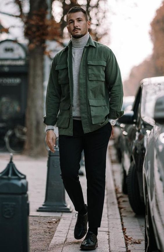 a grey turtleneck, black trousers, black shoes, a green army jacket for a super stylish fall look