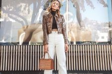 17 a stylish outfit with a black cropped turtleneck, white high waisted jeans, creamy booties, a metallic jacket and a tan bag