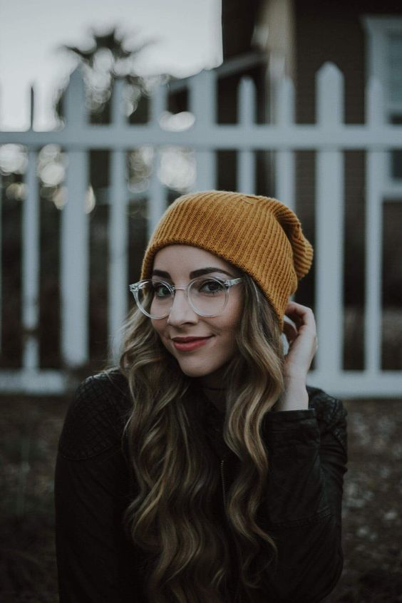 round eyeglasses in a thick clear frame are a great accessory to rock, they are in trend and don't interfere into your style