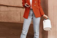 18 a bright fall outfit with a white t-shirt, light blue jeans, white kitten heel booties, a rust blazer and a white bucket bag
