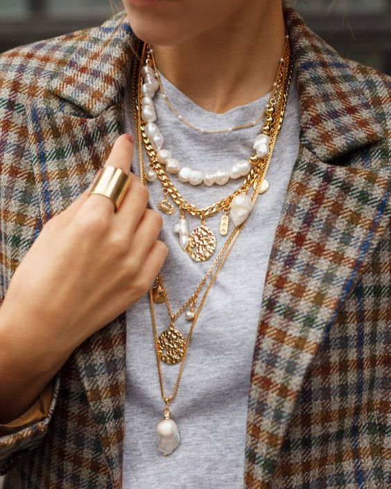 multiple layered necklines with baroque pearls, gold coins, chains and other stuff look just incredible and will make a statement