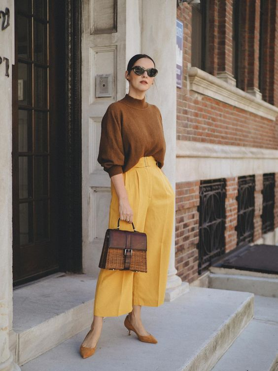 a bold fall outfit with a mustard jumper, mellow yellow culottes, mustard suede shoes and a two tone bag