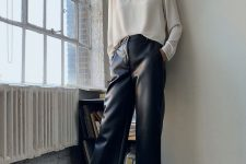 20 a white long sleeve tee, black leather trousers, black boots for a minimalist and stylish fall look