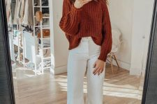 21 a pretty fall look with a rust-colored chunky knit sweater, white cropped jeans, rust-colored suede booties