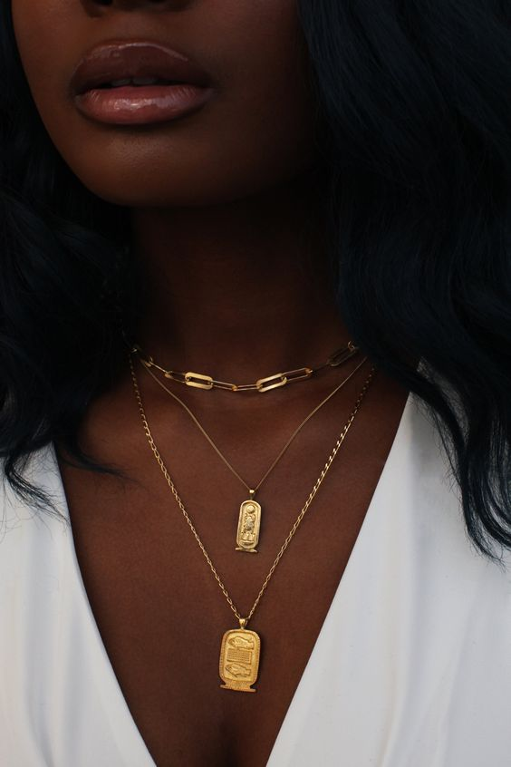 gold necklace layering - a chunky chain choker, two delicate necklaces with statement pendants is amazing