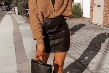 22 a sexy fall look with a black turtleneck, a brown cardigan, a black leather mini skirt, black boots and a black bucket bag